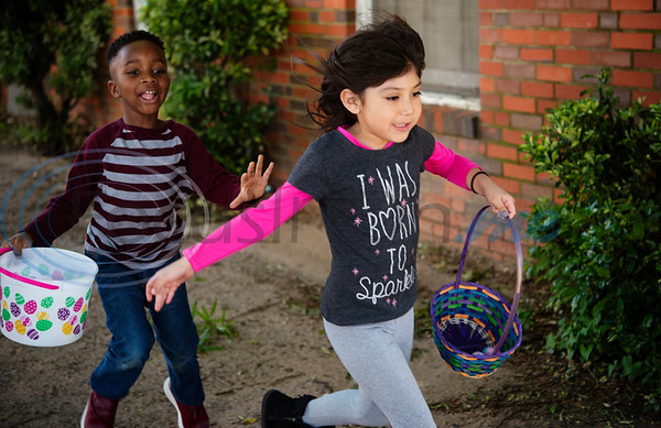Primary Scholars of Excellence after-school program students Asher Moore, 6, and Yuretzi Lopez, 6, run to collect Easter eggs at their hunt held at Dale Chapel Baptist Church in Tyler on Thursday April 18, 2019.   (Sarah A. Miller/Tyler Morning Telegraph)