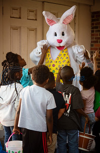 Children visit the Easter bunny after their Easter egg hunt at the Primary Scholars of Excellence after-school program held at Dale Chapel Baptist Church in Tyler on Thursday April 18, 2019.   (Sarah A. Miller/Tyler Morning Telegraph)