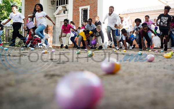 Children run to hunt for Easter eggs at the Primary Scholars of Excellence after-school program held at Dale Chapel Baptist Church in Tyler on Thursday April 18, 2019.   (Sarah A. Miller/Tyler Morning Telegraph)