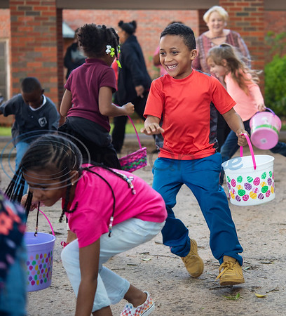 Primary Scholars of Excellence after-school program student Messiah Williams, 6, smiles as he runs to collect Easter eggs at their hunt held at Dale Chapel Baptist Church in Tyler on Thursday April 18, 2019.   (Sarah A. Miller/Tyler Morning Telegraph)