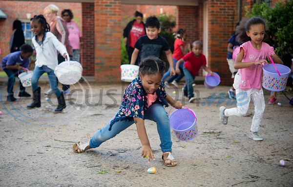 Primary Scholars of Excellence after-school program student Jayla White, 5, reaches for an Easter egg at their hunt held at Dale Chapel Baptist Church in Tyler on Thursday April 18, 2019.   (Sarah A. Miller/Tyler Morning Telegraph)