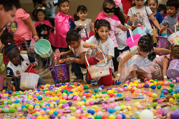 Children collect as many eggs as they can in one minute at the Tyler Parks and Recreation's 18th Annual Twilight Easter Egg Hunt at the Glass Recreation Center on Thursday April 18, 2019.   (Sarah A. Miller/Tyler Morning Telegraph)