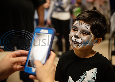 Anthony Crespo, 4, of Tyler, has his face painted like a wolf at the Tyler Parks and Recreation's 18th Annual Twilight Easter Egg Hunt at the Glass Recreation Center on Thursday April 18, 2019.   (Sarah A. Miller/Tyler Morning Telegraph)
