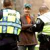 Michael Lundy of Grand Junction talks to CUPD Officer Josh Trevtler, left and Sgt.  Vinne Monfez of the Boujlder County Sheriff's Department as they give him a ticket for possession of marijuana on Norlin Quad on Wednesday afternoon on the CU Boulder Campus.<br /> Photo by Paul Aiken