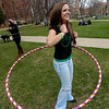 Lacie, who asked that her last name not be used, uses a hula hoop during 4/20 celebrations on the Norlin Quad on Wednesday afternoon on the CU Boulder Campus.<br /> Photo by Paul Aiken