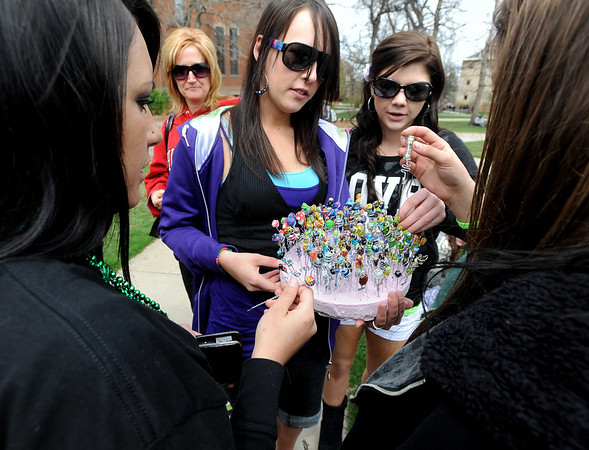 "Chelsea Tindall, center, sold pot pokers during the festivities.<br /> Several hundred people made their way to the CU campus to indulge in marijuana on 4/20. For several videos and photos of the event, go to  <a href=""http://www.dailycamera.com"">http://www.dailycamera.com</a>.<br /> Cliff Grassmick/ April 20, 2011"