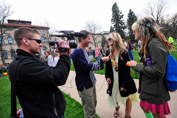 POT<br /> Ryan Van Duzer, center, interviews revelers at the end of the 4/20 smoke-out on the University of Colorado campus on Wednesday. At left is cameraman Ian Cofrin.<br /> Photo by Marty Caivano/April 20, 2011