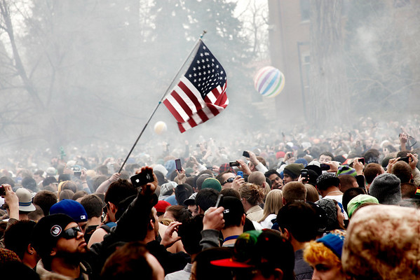 Smoke rises above thousands of people who gathered Wednesday for the 4/20 smoke out festival on the University of Colorado campus in Boulder April 20, 2011. Chancey Bush/ The Camera.