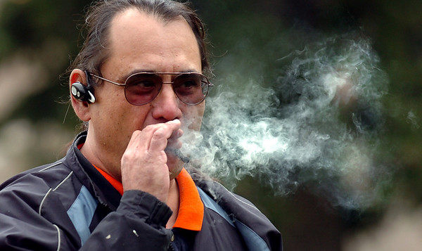 Dan Moller smokes a marijuana cigarette on Norlin Quad on Wednesday afternoon on the CU Boulder Campus.<br /> Photo by Paul Aiken