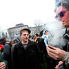 POT<br /> Andrew Quintana, left, watches as Mike Frith takes a hit from a joint during the 4/20 smoke-out on the University of Colorado campus on Wednesday. The man in the center declined to give his name.<br /> Photo by Marty Caivano/April 20, 2011
