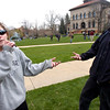 Samantha Rowe and Dan Moller share a joint during 4/20 celebrations on the Norlin Quad on Wednesday afternoon on the CU Boulder Campus.<br /> Photo by Paul Aiken