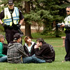 CUPD Detective Paul Davis, left and Boulder Police Department Officer M. Trujillo issue tickets for possession of marijuana to a group on the Norlin Quad on Wednesday afternoon on the CU Boulder Campus.<br /> Photo by Paul Aiken