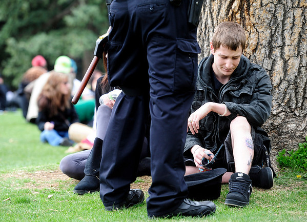 POT<br /> A reveler receives a ticket from the Boulder police during the 4/20 smoke-out on the University of Colorado campus on Wednesday.<br /> Photo by Marty Caivano/April 20, 2011