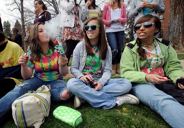 """McKenzie Lange, left,  Delaney Chandler,  and Brianna Crauser, begin their 4/20 pot smoking experience on Wednesday.<br /> Several hundred people made their way to the CU campus to indulge in marijuana on 4/20. For several videos and photos of the events, go to  <a href=""""http://www.dailycamera.com"""">http://www.dailycamera.com</a>.<br /> Cliff Grassmick/ April 20, 2011"""