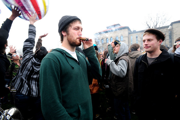 POT<br /> Andrew Quintana, left, takes a hit from a joint during the 4/20 smoke-out on the University of Colorado campus on Wednesday. The man at right declined to give his name. <br /> Photo by Marty Caivano/April 20, 2011