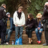 Officer A. Trojanowski, left and Sgt M. Dodson of the CU Police issue two marijuana tickets to 4 people on the Norlin Quad on Wednesday afternoon on the CU Boulder Campus. The 3 people on the bench refused to give their names. The standing man identified himself as Luke from Denver. <br /> Photo by Paul Aiken