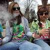 "Delaney Chandler, left, and Brianna Crauser, begin their 4/20 pot smoking experience on Wednesday.<br /> Several hundred people made their way to the CU campus to indulge in marijuana on 4/20. For several videos and photos of the events, go to  <a href=""http://www.dailycamera.com"">http://www.dailycamera.com</a>.<br /> Cliff Grassmick/ April 20, 2011"