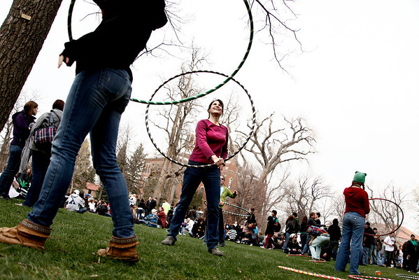 Jody Evans hula hoops before the 4/20 festival on the University of Colorado campus in Boulder April 20, 2011.Chancey Bush/ The Camera
