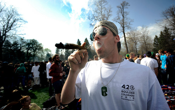 Garrett Kramer smokes a large blunt during the 4/20 event on Norlin Quad at the University of Colorado in Boulder, Colorado April 20, 2010.  CAMERA/Mark Leffingwell