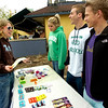 "CU Senior Kelsey Wentz takes advantage of the freebies at the New Leaf Wellness 4/20 specials table set up on Broadway across from the University of Colorado Boulder Campus on Tuesday afternoon April 20, 2010. Working the table from left to right are Lauren Simmons, Ryan Miller and Dom Schatz. Wentz said she wanted to attend 420 on campus but has 4 papers due. ""It's killing me not to go,"" she said.<br /> Photo by Paul Aiken The Camera"