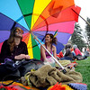 0420SMOKE5.jpg A friend and Janice Savonen (right) laugh and talk under their big umbrella during the 4/20 event on Norlin Quad at the University of Colorado in Boulder, Colorado April 20, 2010.  CAMERA/Mark Leffingwell