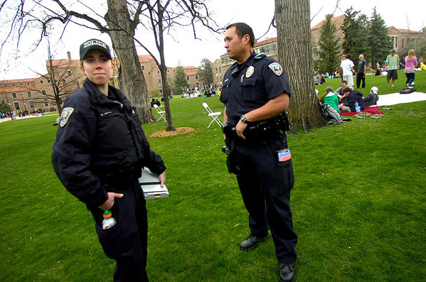University of Colorado police who asked not to be identified look over the crowd in the Norlin Quad at the start of 4/20 celebrations on the CU Boulder campus on Tuesday April 20, 2010. <br /> Photo by Paul Aiken The Camera