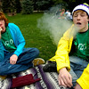 Blake Cassetta, left and Sean Hoffman, both of Colorado Springs take a hit on marijuana cigarettes in the Norlin Quad at the start of 4/20 celebrations on the CU Boulder campus on Tuesday April 20, 2010. <br /> Photo by Paul Aiken The Camera