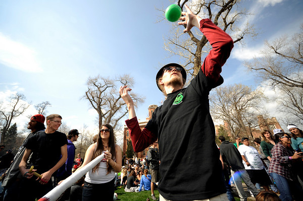 0420SMOKE6.jpg Will Benson contact juggles during the 4/20 event on Norlin Quad at the University of Colorado in Boulder, Colorado April 20, 2010.  CAMERA/Mark Leffingwell