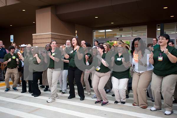 photo by Sarah A. Miller/Tyler Morning Telegraph  Walmart Neighborhood Market associates perform a cheer at the ribbon cutting ceremony as the store officially opens Wednesday morning. The store, located at 1900 ESE Loop 323 in Tyler, offers quick and convenient shopping, with a full-grocery department featuring prepared food options, fresh baked breads, gluten-free options, a deli and a bakery. It also has a pharmacy.