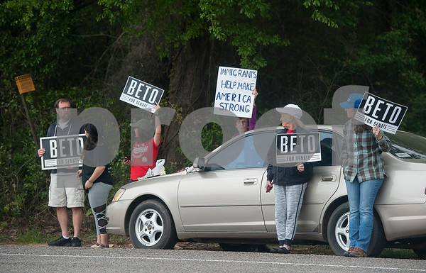 People hold signs for Beto O'Rourke, the 2018 Democratic Candidate for U.S. Senate in Texas outside of a re-election campaign stop event in Tyler for United States Sen. Ted Cruz, R-Tx., at John Soules Foods on Monday April 2, 2018.    (Sarah A. Miller/Tyler Morning Telegraph)