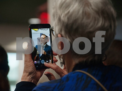 A woman takes a photograph of United States Sen. Ted Cruz with a cell phone during a re-election campaign stop in Tyler at John Soules Foods on Monday April 2, 2018.    (Sarah A. Miller/Tyler Morning Telegraph)