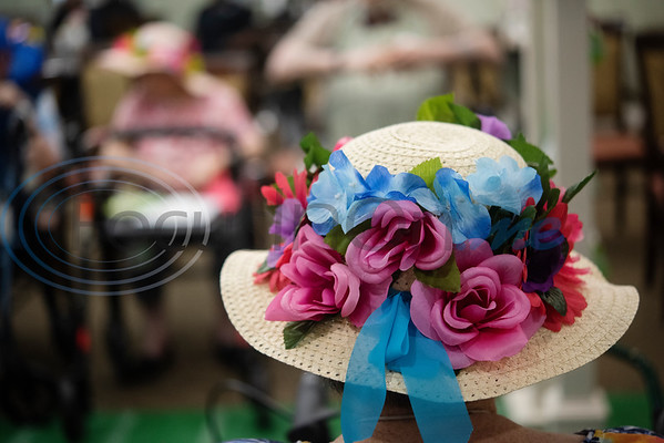 Prestige Estates resident Nancy Duress, 82, wears a flower decorated hat at the Kentucky Derby stick-horse race at the assisted living facility in Tyler on Tuesday April 23, 2019.   (Sarah A. Miller/Tyler Morning Telegraph)