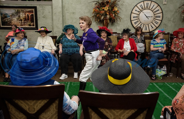 Prestige Estates Community Relations Liaison JoAnn McMeans warms up and entertains residents before the start of their Kentucky Derby race at the assisted living facility in Tyler on Tuesday April 23, 2019.  (Sarah A. Miller/Tyler Morning Telegraph)