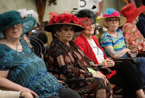 Prestige Estates residents wear flower decorated hats at the Kentucky Derby stick-horse race at the assisted living facility in Tyler on Tuesday April 23, 2019.   (Sarah A. Miller/Tyler Morning Telegraph)