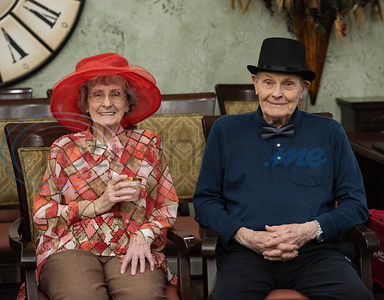 Prestige Estates residents Martha Miley, 92, and David Crim, 88, wears hats as they attend the Kentucky Derby stick-horse race at the assisted living facility in Tyler on Tuesday April 23, 2019.   (Sarah A. Miller/Tyler Morning Telegraph)
