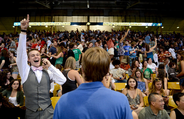 University of Colorado freshman Thomas Franklin, left, waves to a friend after securing a front row seat for a speech by President Barack Obama at the Coors Events Center at the University of Colorado in Boulder on Tuesday, April 24, 2012.<br /> <br /> (Greg Lindstrom/Times-Call)