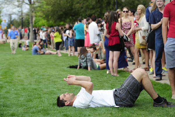 CU student Guillermo Baca rests in the grass as he waits in the long line  to get into the President Obama speech on the CU Campus on Tuesday. The line snaked all over campus. <br /> Photo by Paul Aiken April 24, 2012