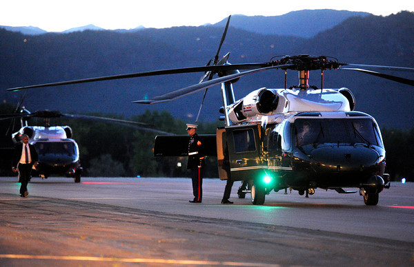 A United States Marine waits beside the Marine One helicopter before taking off at the Boulder Municipal Airport on Tuesday, April 24, after President Barack Obama's speech at the University of Colorado.<br />  Jeremy Papasso/ Camera