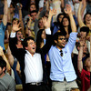 "Aleksey Treskov (left) and Faisal Albirdisi (right) join in doing ""the wave"" while waiting for President Barack Obama's speech at the University of Colorado in Boulder, Colorado April 24, 2012. CAMERA/MARK LEFFINGWELL"