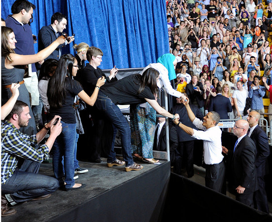 President Barack Obama moves to greet some of the crowd at the Coors Events Center on the University of Colorado Campus during his speech on Tuesday April 24, 2012 in Boulder. Photo by Jeremy Papasso April 24, 2012