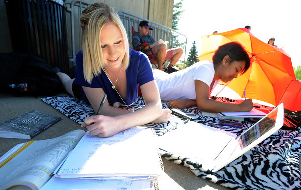 "Sarah Boline, left, and Aisha Thurmond, both CU students, were prepared with homework while waiting at the Coors Events Center on Tuesday.<br /> For more photos and a video of the Obama visit, go to  <a href=""http://www.dailycamera.com"">http://www.dailycamera.com</a><br /> Cliff Grassmick / April 24, 2012"