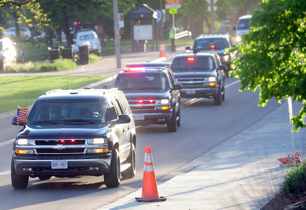 The presidential motorcade comes down Regent Drive on Tuesday afternoon. <br /> Photo by Paul Aiken April 24, 2012