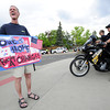 David Zabel of Louisville looks around for a good spot to protest as University of Colorado Police Officers A. Trojanowski, left and K. Pacheco look on prior to the President Obama speech on the CU Campus on Tuesday.<br /> Photo by Paul Aiken April 24, 2012