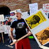 "Brian Ruddle, a CU junior, joined about 30 people protesting Obama policies at the UMC on Tuesday.<br /> For more photos and a video of the Obama visit, go to  <a href=""http://www.dailycamera.com"">http://www.dailycamera.com</a><br /> Cliff Grassmick / April 24, 2012"