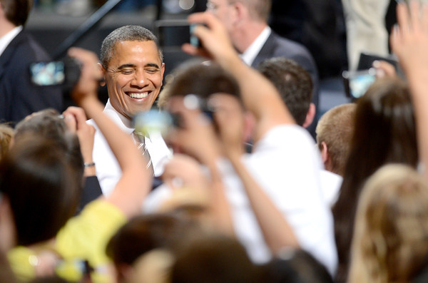 President Barack Obama smiles for photos after his speech at the University of Colorado in Boulder, Colorado April 24, 2012. CAMERA/MARK LEFFINGWELL