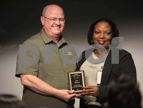 East Texas Crisis Center volunteer coordinator Angela Gray, right, presents Jim McKee of Help Center Crime Victims Services an award at the East Texas Crisis Center Hope Awards ceremony held Thursday April 27, at Tyler Public Library's Taylor Auditorium. April is Sexual Assault Awareness Month. Awards were presented to outstanding citizens who have gone above and beyond as volunteers and professionals to help victims of sexual violence.   (Sarah A. Miller/Tyler Morning Telegraph)