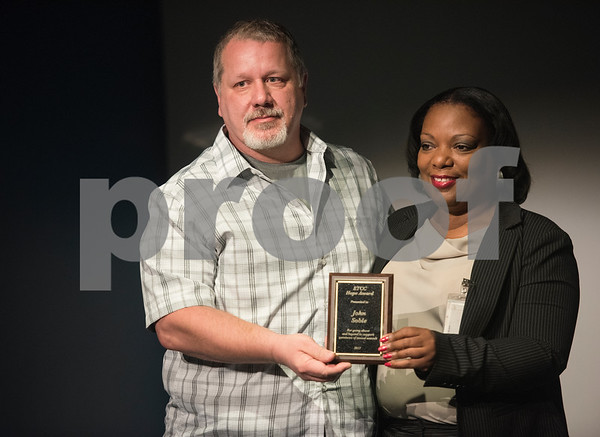 East Texas Crisis Center volunteer coordinator Angela Gray, right, presents volunteer John Soble an award at the East Texas Crisis Center Hope Awards ceremony held Thursday April 27, at Tyler Public Library's Taylor Auditorium. April is Sexual Assault Awareness Month. Awards were presented to outstanding citizens who have gone above and beyond as volunteers and professionals to help victims of sexual violence.   (Sarah A. Miller/Tyler Morning Telegraph)