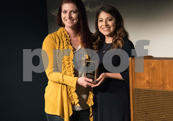 East Texas Crisis Center sexual assault program coordinator Pamela Ortega, right, presents sexual assault nurse examiner Alisha Harding an award at the East Texas Crisis Center Hope Awards ceremony held Thursday April 27, at Tyler Public Library's Taylor Auditorium. April is Sexual Assault Awareness Month. Awards were presented to outstanding citizens who have gone above and beyond as volunteers and professionals to help victims of sexual violence.   (Sarah A. Miller/Tyler Morning Telegraph)