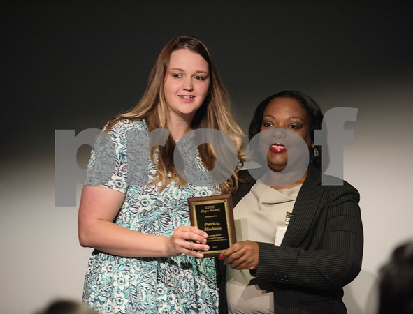 East Texas Crisis Center volunteer coordinator Angela Gray, right, presents volunteer Patricia Madison an award at the East Texas Crisis Center Hope Awards ceremony held Thursday April 27, at Tyler Public Library's Taylor Auditorium. April is Sexual Assault Awareness Month. Awards were presented to outstanding citizens who have gone above and beyond as volunteers and professionals to help victims of sexual violence.   (Sarah A. Miller/Tyler Morning Telegraph)