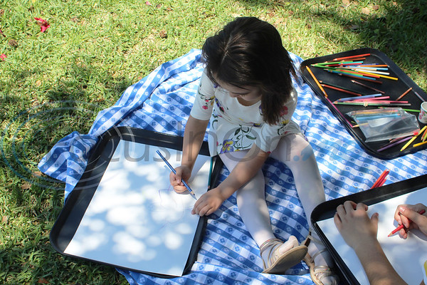 Laura Salter doodles at the Tyler Rose Garden during the 13th Annual Art in the Garden event. Sarah Perez/Freelance
